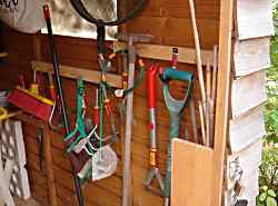 An array of tools hangs in a prescribed order on my shed wall.